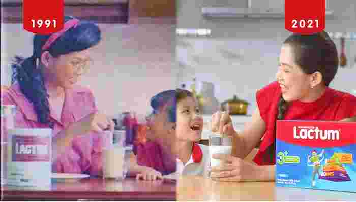 mom and kid enjoying a glass of milk showing motherhood through the years remain the same