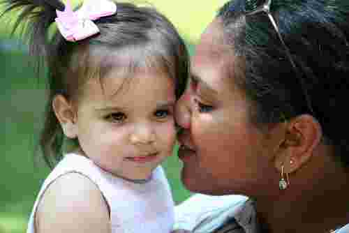 Black woman with white adopted baby