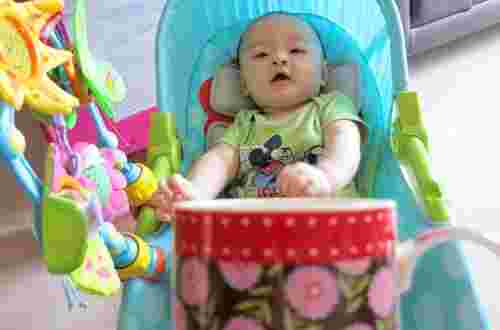Baby Kieran Boo at 5 months old being mugged!