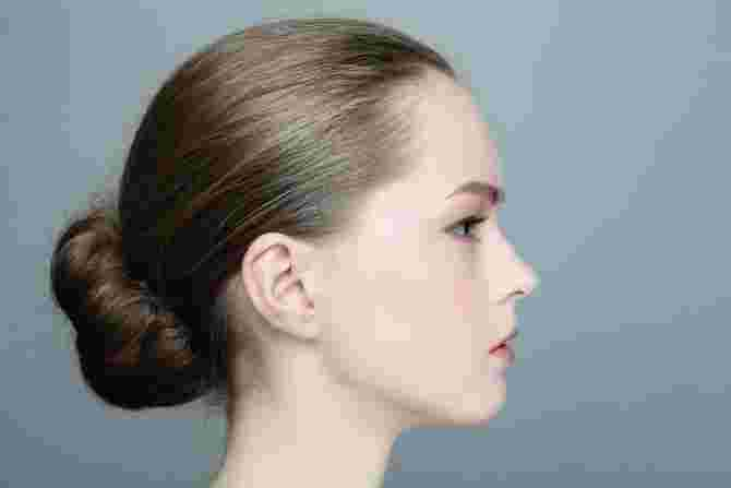 Chic buns are a neat way to hide slight hair thinning.