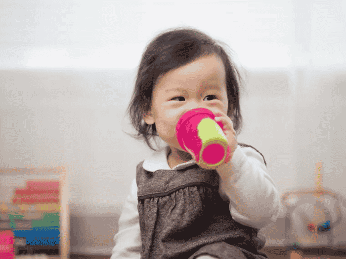 Girl drinking from suppy cup