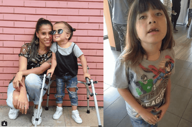 mother carries child with cerebral palsy