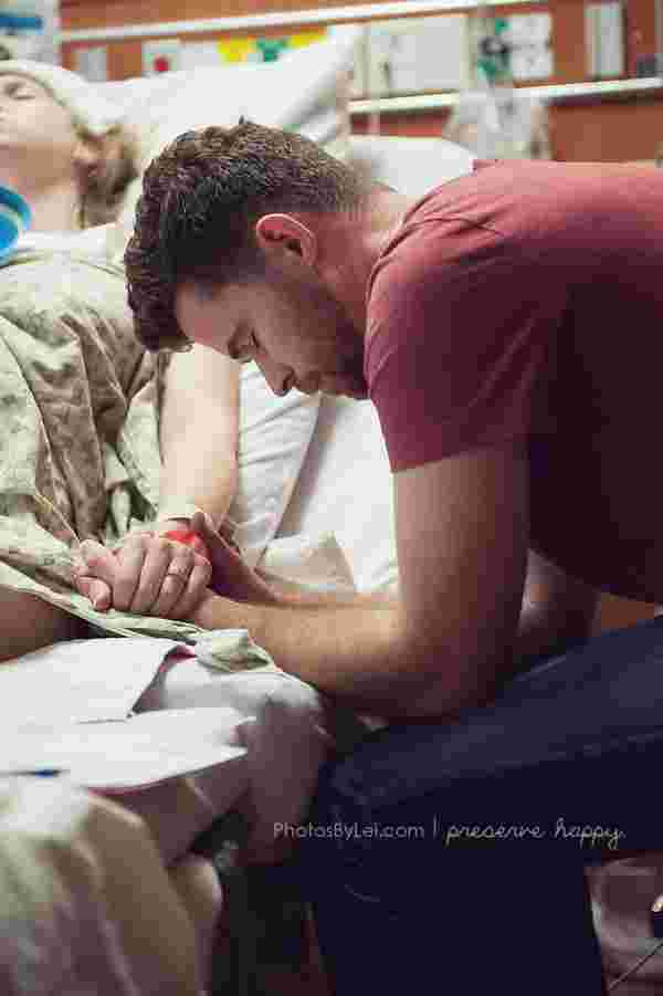 This father is praying that his baby will arrive safely.