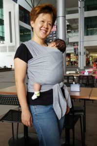 """I love stretchies for their ease of use. Pre-tie, pop baby in and go. Babywearing saved my sanity during confinement! Wearing Xayne enabled me to eat and do household chores while still keeping him close. Win-win."" - Melisa Goh with her newborn"