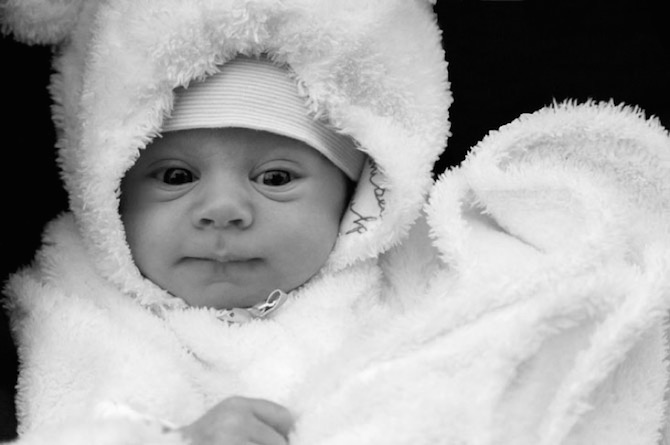 baby in furry dress for winter