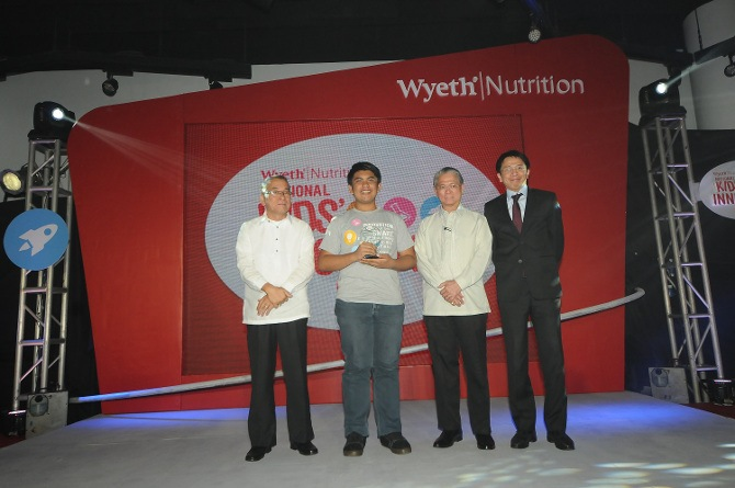 Jejomar Derecho, who invented the Tri-Axis Accelerometer as Commercial Seismic Wave Sensor is recognized at the Wyeth Nutrition National Kids' Innovation Day