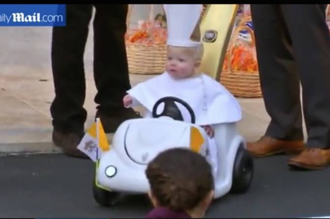 cute baby dressed as the pope
