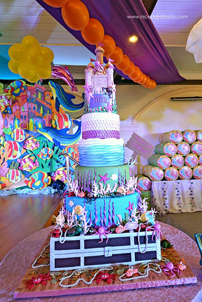 The delectable candy-colored cake towered over guests