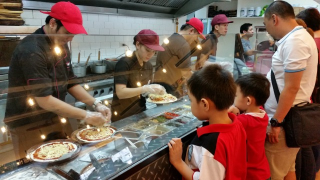 1. Kids and adults can customize their pizzas