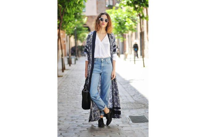 Pair 'mom jeans' with a long sheer cardigan for a boho chic vibe