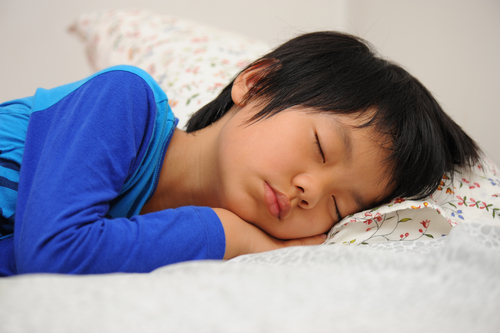 Is it normal for my child to snore while he sleeps?
