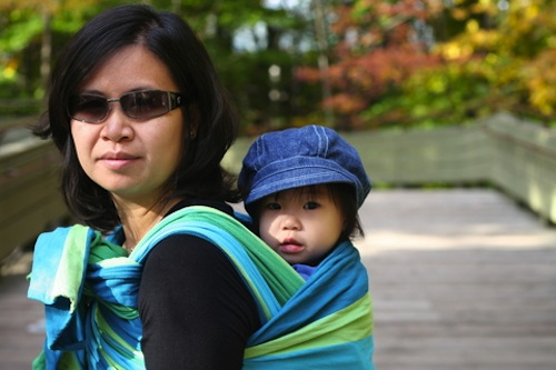The solution to traveling with a toddler without a stroller: Babywearing!