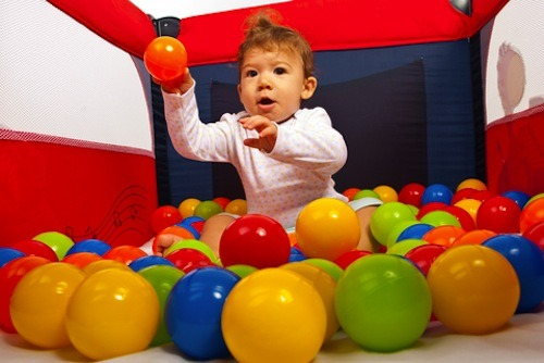 Play ball with your toddler so that she will know the proper time and place for throwing things.