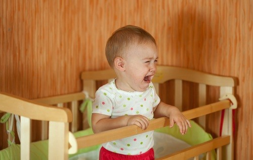 baby-crying-wooden-crib