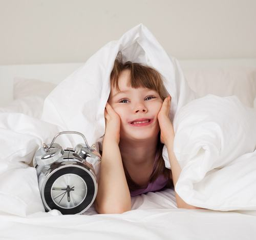 shutterstock 65743219 Tricking kids to wake up in the morning