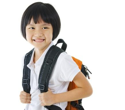 What age can Singapore children start walking to school alone by themselves?