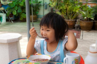Get your child to adopt good eating habits.