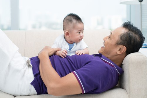shutterstock 132457307 Why do men only hold their own babies?