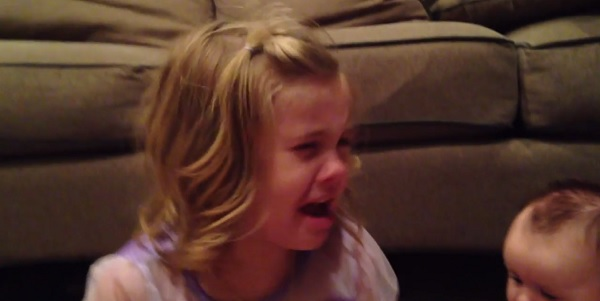 Cute video! Little girl does NOT want her baby brother to grow up