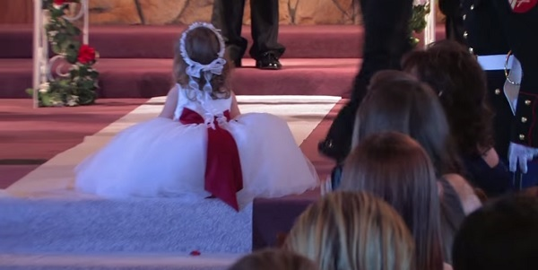 Flower girl makes everyone laugh during wedding- Hilarious video!