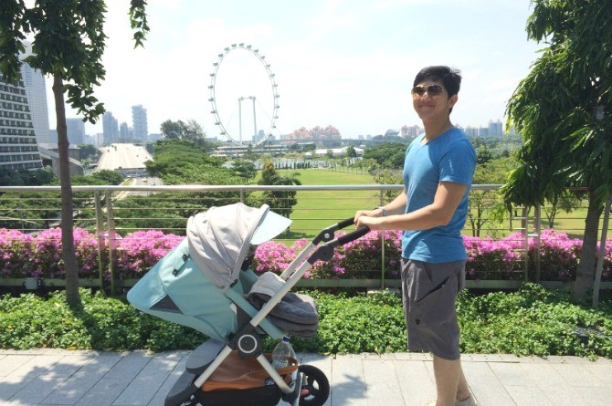"dad and baby stokke ""Our son loves being zipped around town in his Stokke Scoot"""