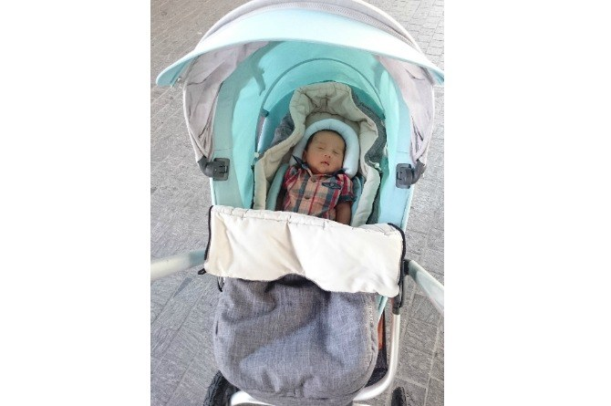 "stokke scoot baby pic ""Our son loves being zipped around town in his Stokke Scoot"""