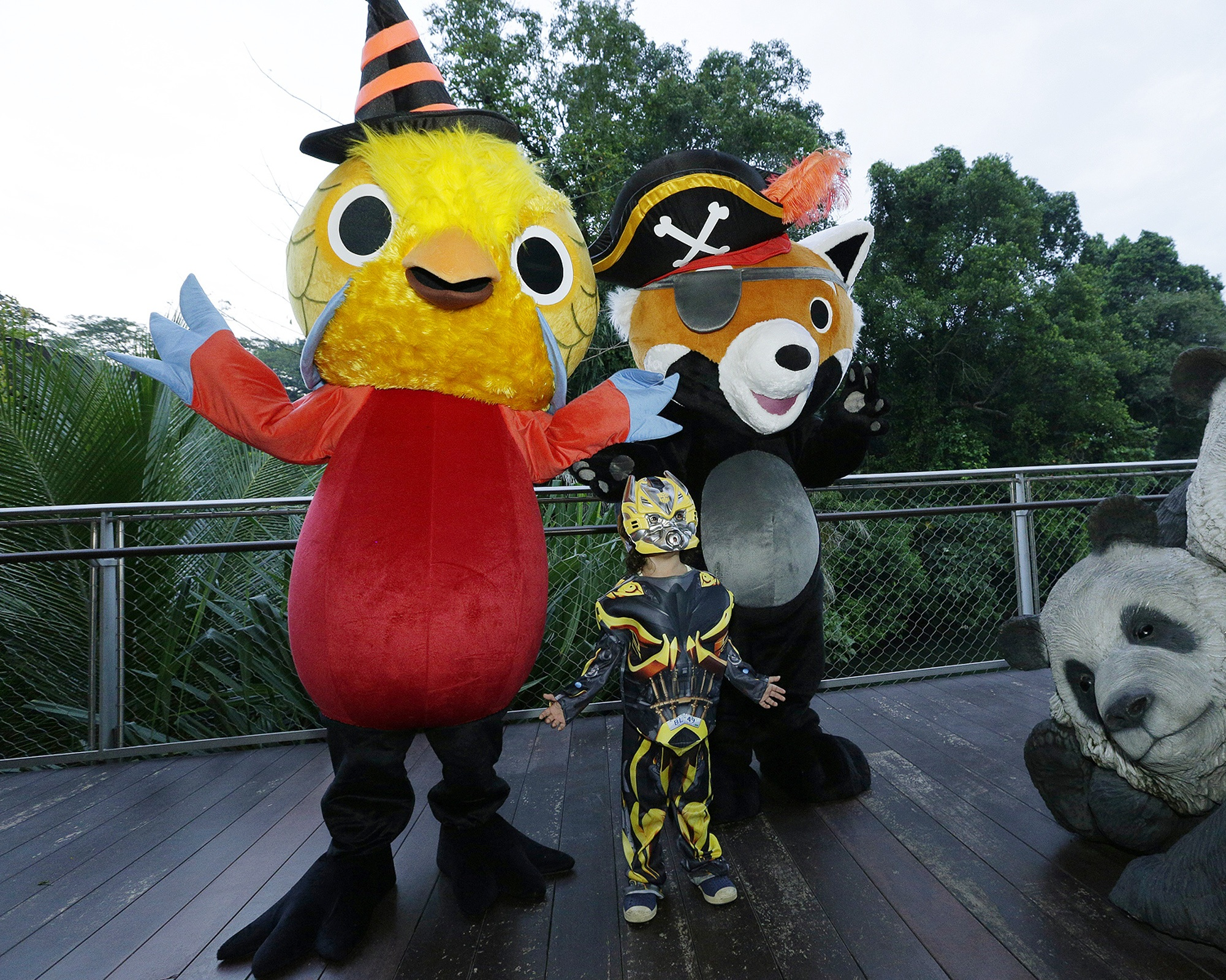 Safari Boo opening night - kid with golden pheasant & red panda mascots