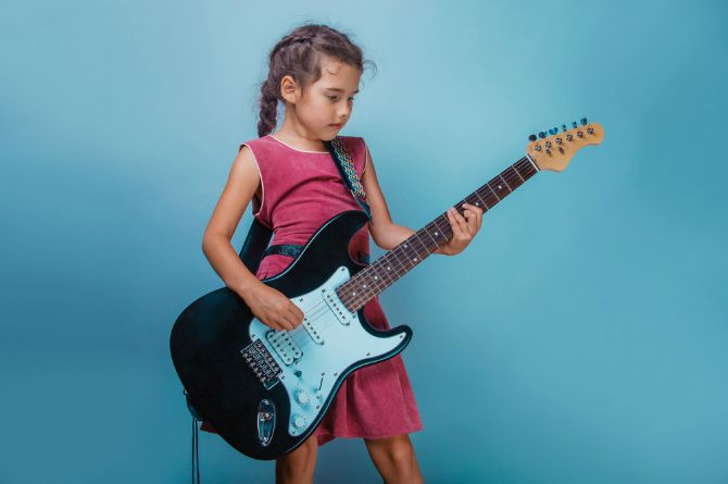 kid playing instrument, girl, child, electric guitar, hidden talents
