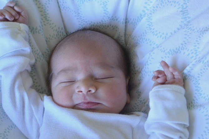 First smile baby newborn infant sleep nap