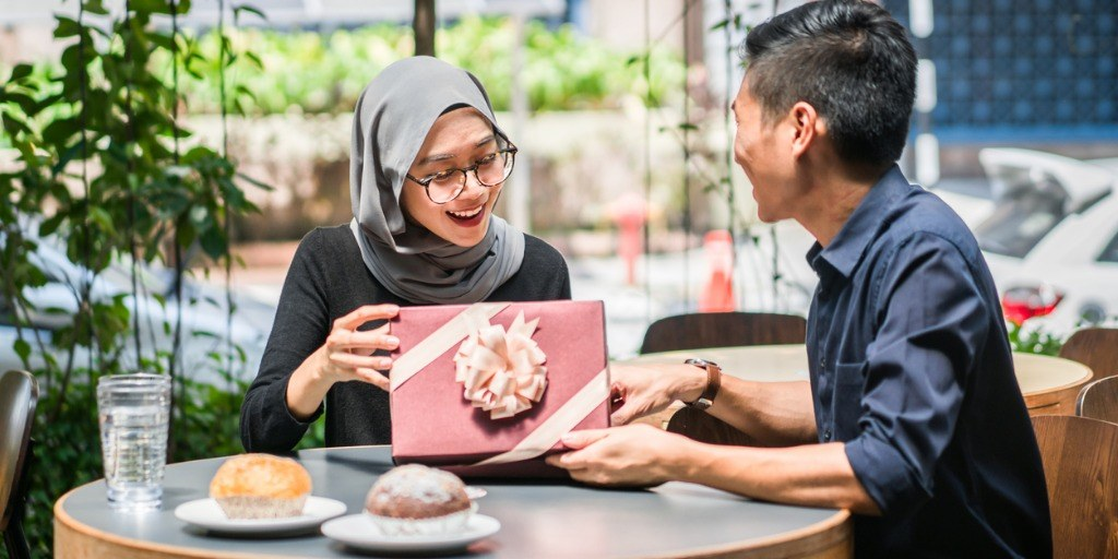 Woman receiving gift from partner