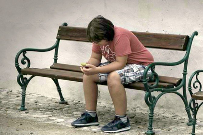 dangerous children's game, boy, sad, phone, alone, depressed, bullied