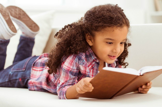 girl reading 8 Books your 8 year old child MUST read this year!