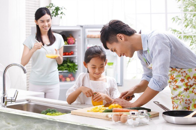family cooking together 5 Ways to increase your child's appetite