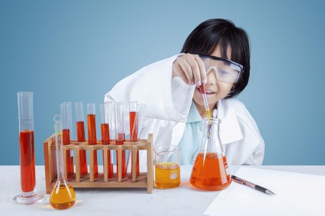 "girl doing science Experiential Learning to ""Excite Children to Excel"""