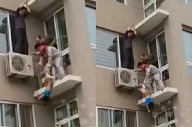 toddler caught falling from building