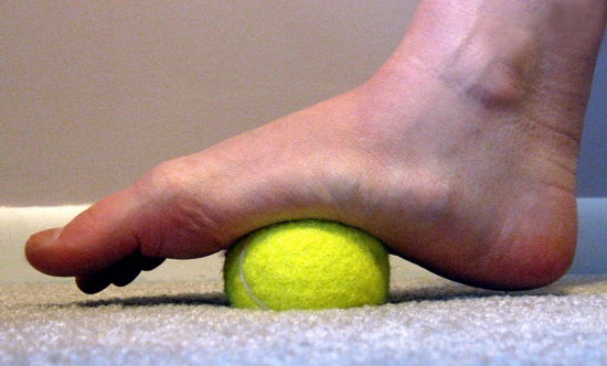 Tennis balls for achy feet