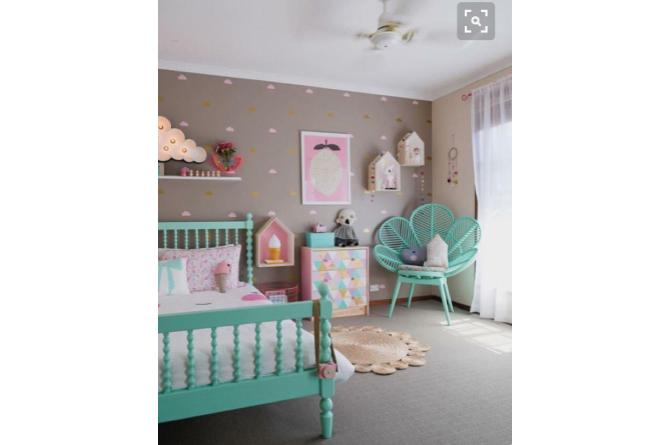 8. This gorgeous room uses matching pops of color to set off the neutral color scheme