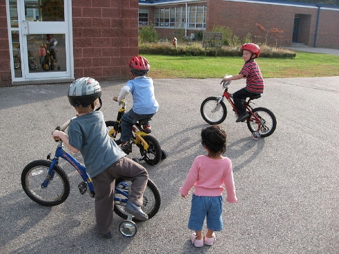 7. Teaching a child to ride a bike for the first time.