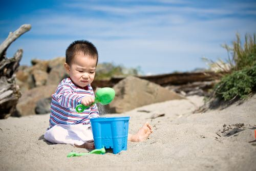 boy toddler sand play_s26