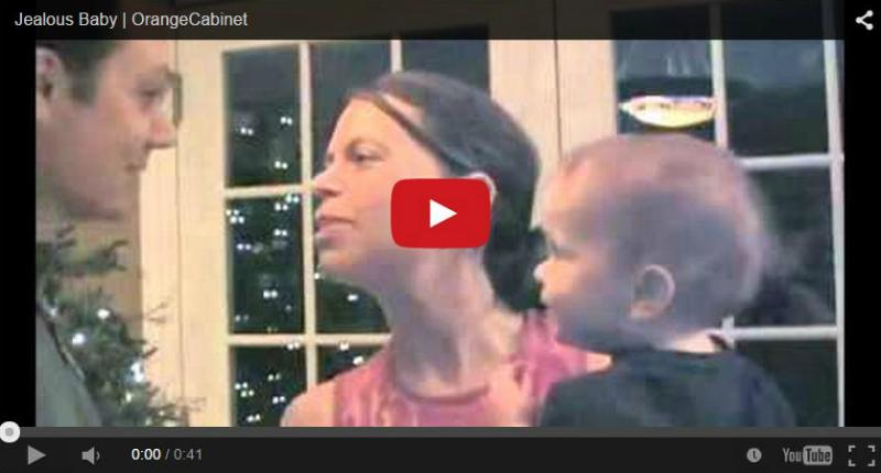 Jealous baby doesn't let dad get the last kiss - Cute video!