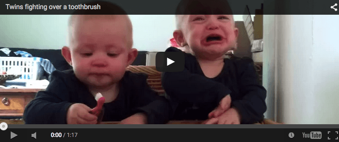 Funny baby video: Twins fight over a brush
