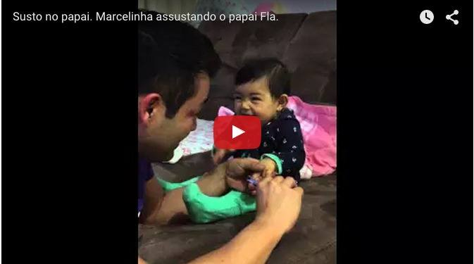 Baby girl knows how to play a prank on her dad already!