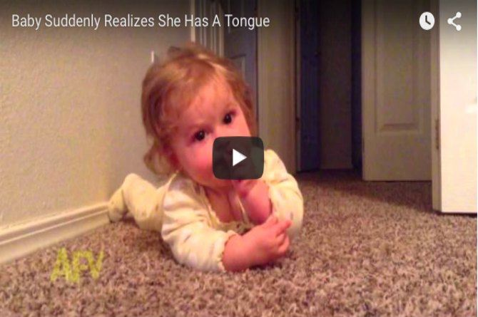 This baby just realised that she has a tongue