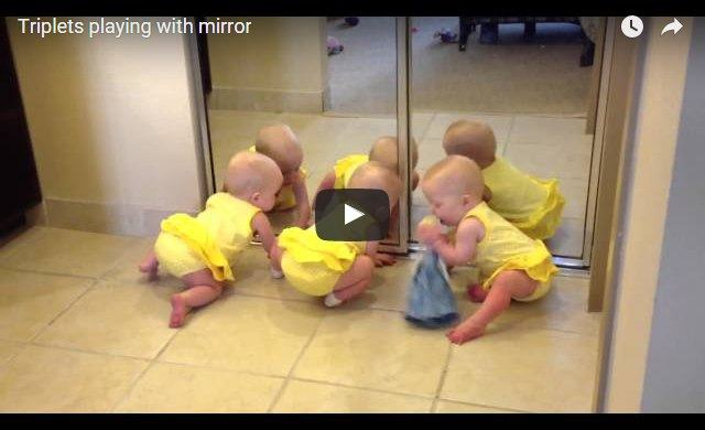 Video of cute triplets playing with mirror
