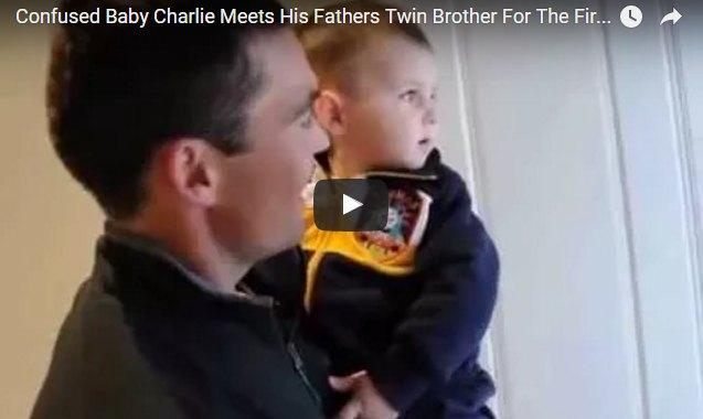 This baby meets his father's twin brother for the first time