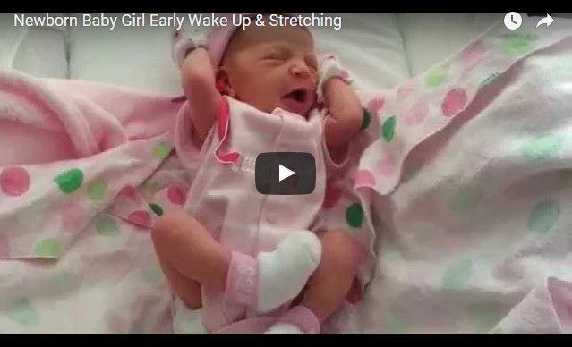 Look at this newborn baby girl waking up and stretching