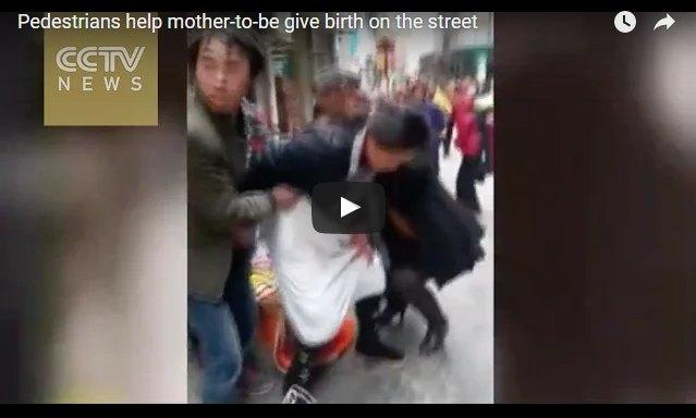 Pedestrians help woman give birth on the street in China