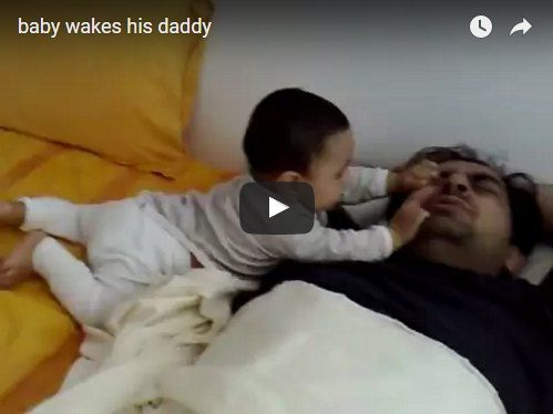 This baby does all that he can to wake up daddy