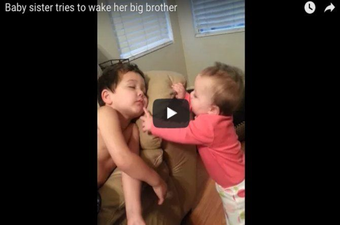 This little girl does all that she can to wake up her big brother