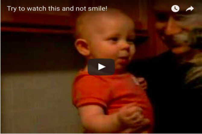 This 10-month old is totally amused by a puppet